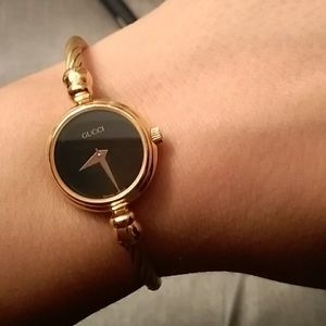 Authentic Black and Gold Gucci watch